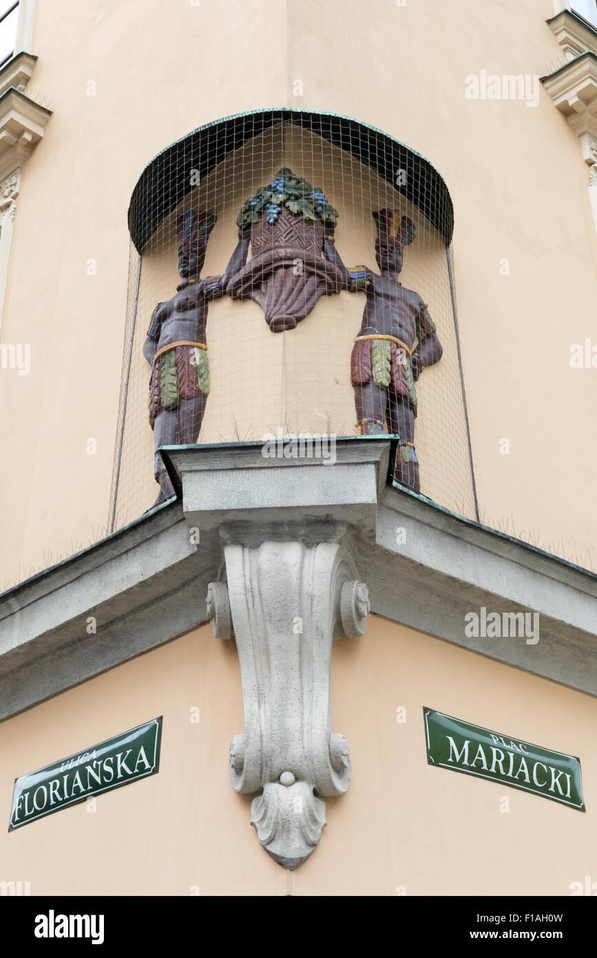 Mural of Africans Florianska & Matiacki carrying grapes Krakow Poland - Stock Image