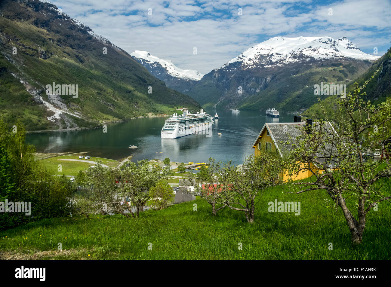 Geiranger town and fjord. Cruise ship at anchor - Stock Image