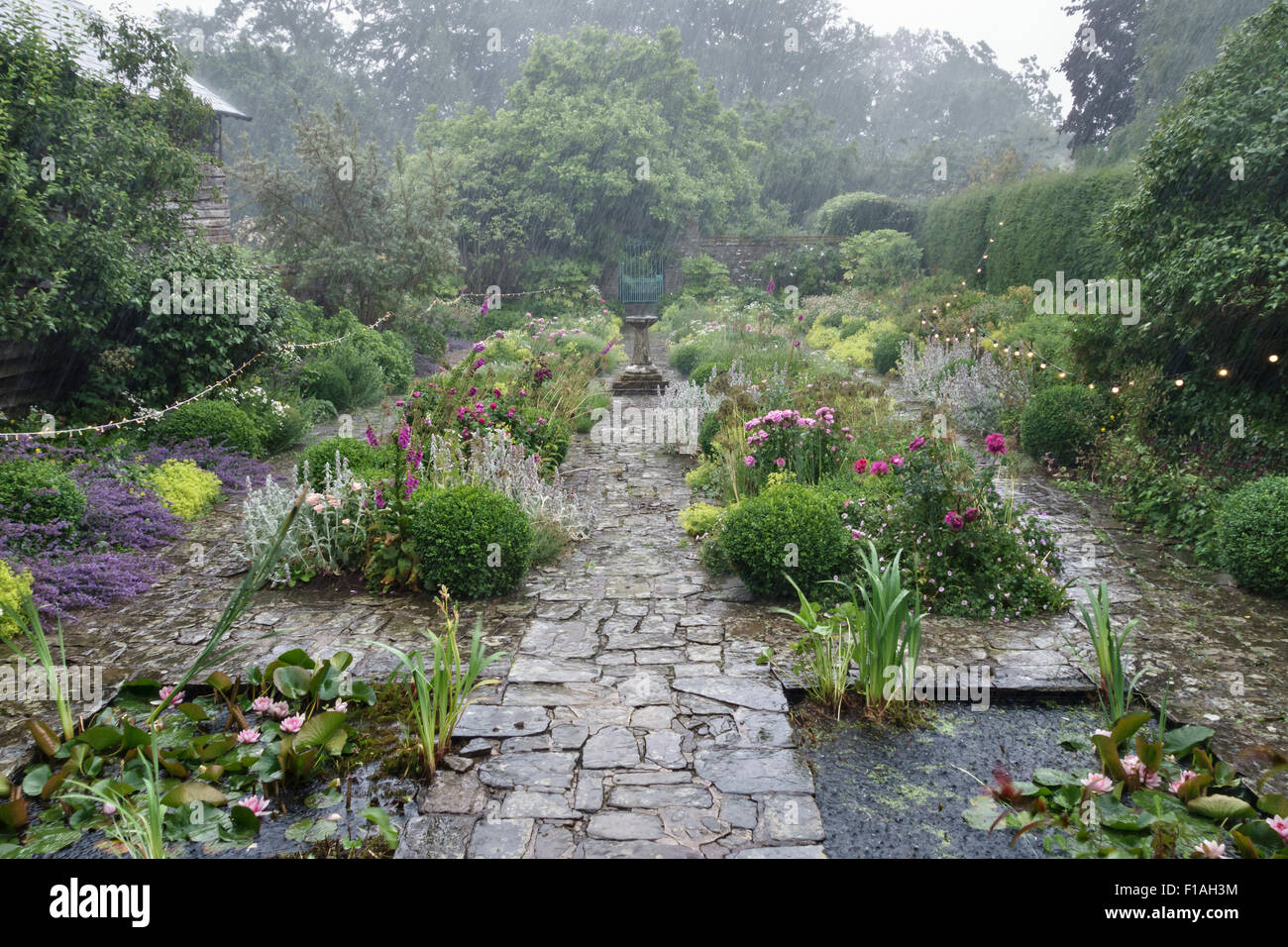 Wales, UK. A garden is drenched by heavy rain during a party in the wet summer of 2015 Stock Photo