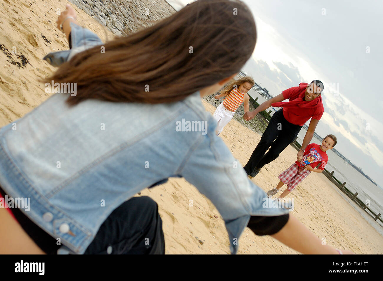 A family enjoying the Three Shells beach at Southend. Essex. UK - Stock Image