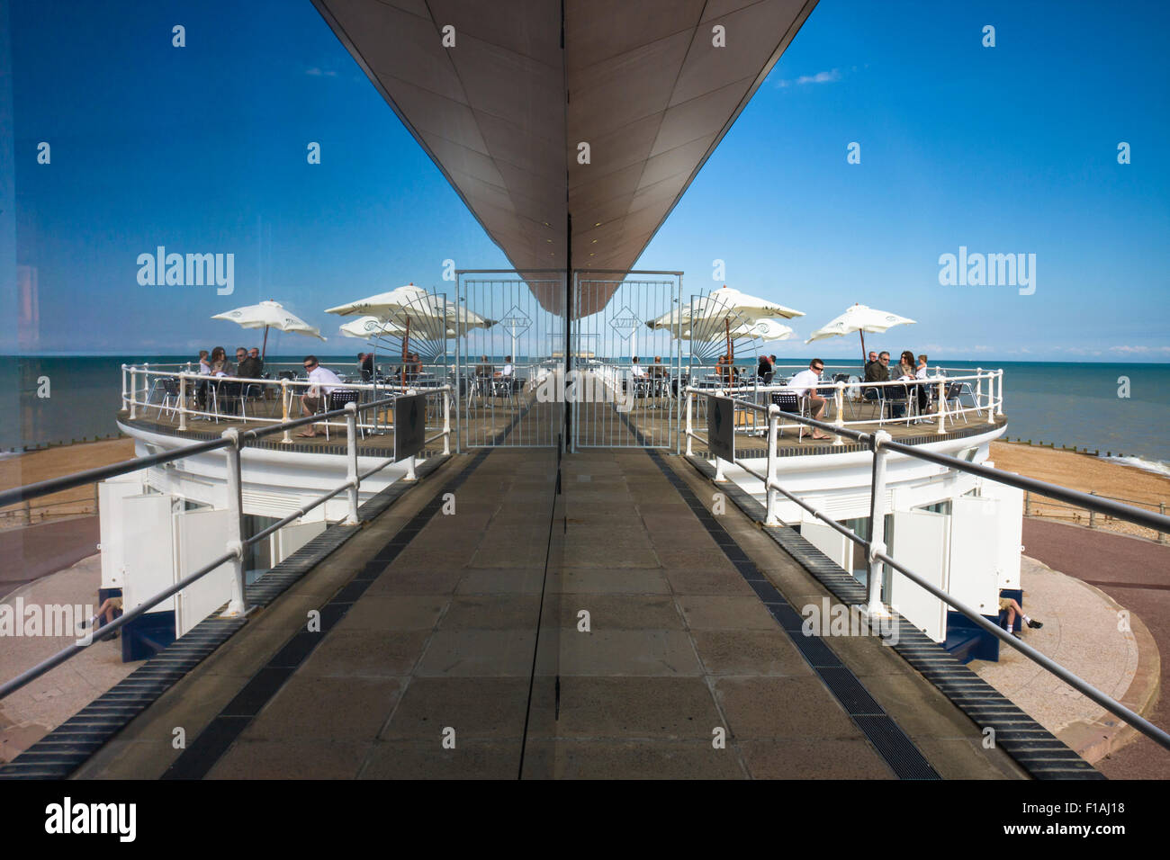 Reflections of the Azur restaurant and seafront at the Marina Pavilion, a 1930's building on the promenade St - Stock Image