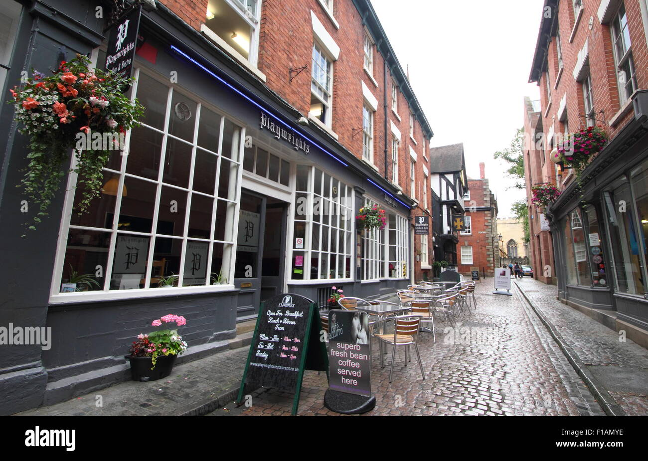 Hay Lane in Coventry's Cathedral quarter looking to  Playwright's cage and restaurant (l), Coventry city - Stock Image