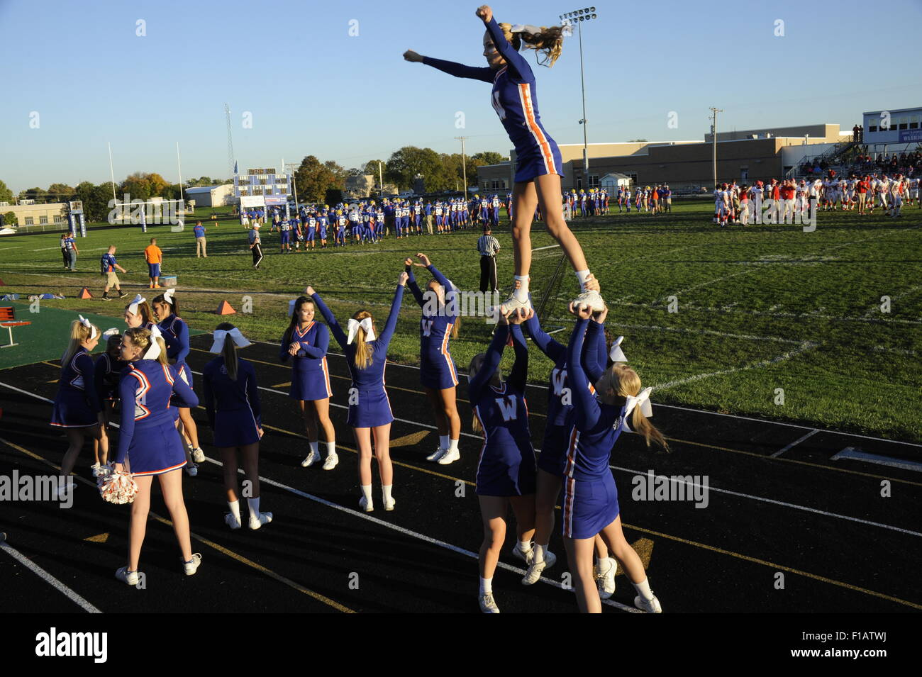 Cheerleaders at football game, Whiteland, Indiana - Stock Image