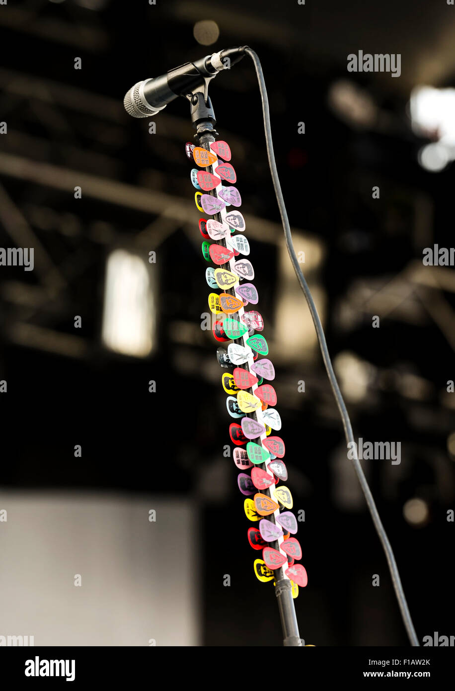 Rick Nielsen's microphone stand of the rock band  'Cheap Trick'  with spare picks - Stock Image