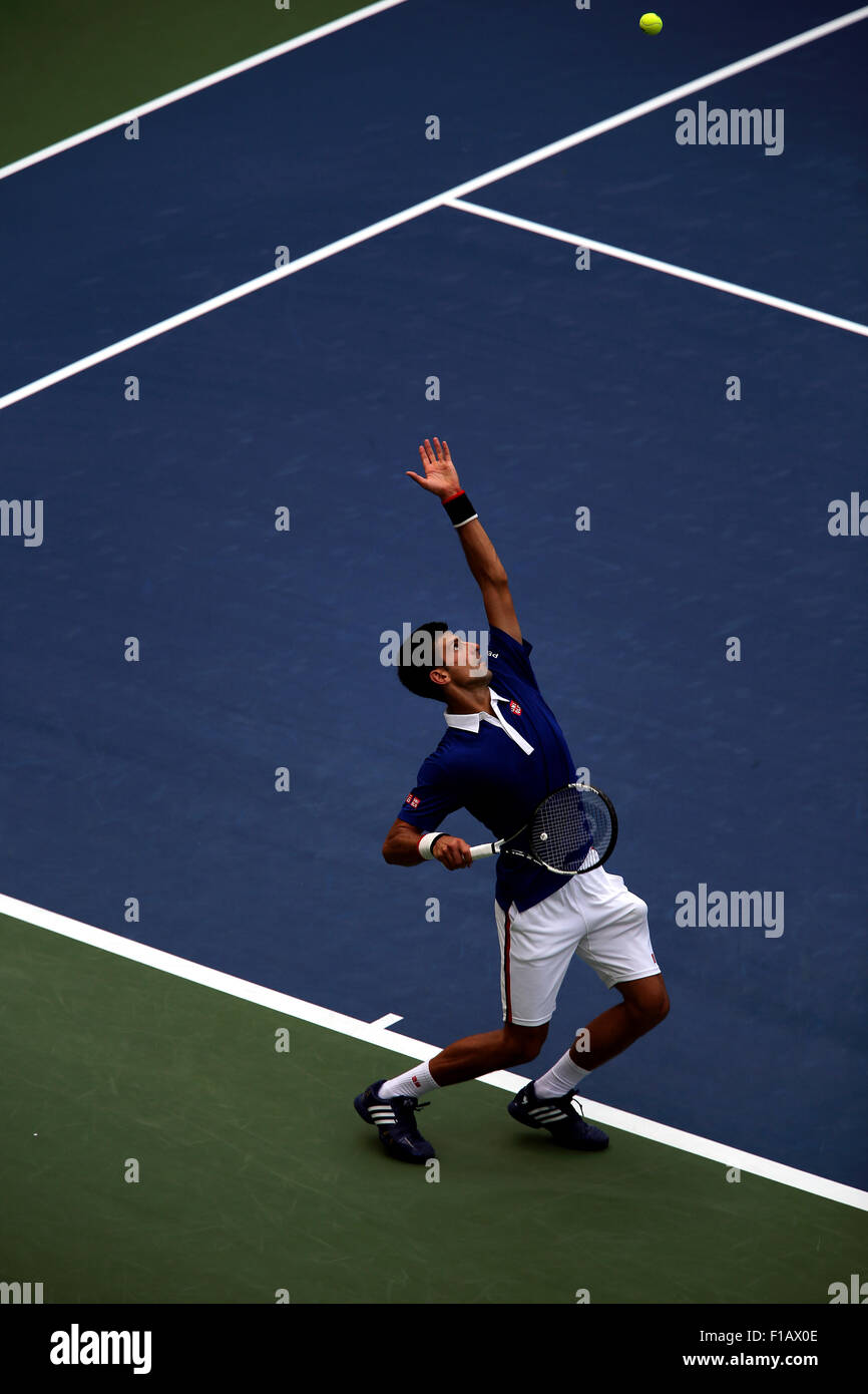 New York, USA. 31st Aug, 2015. Number one seed Novak Djokovic serving in first round action against Joao Souza of - Stock Image