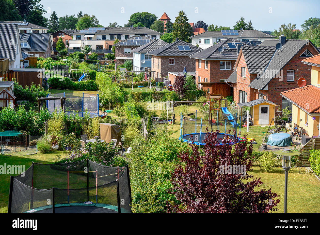 Newly built housing with child-friendly gardens in Preetz, Schleswig-Holstein, Germany - Stock Image