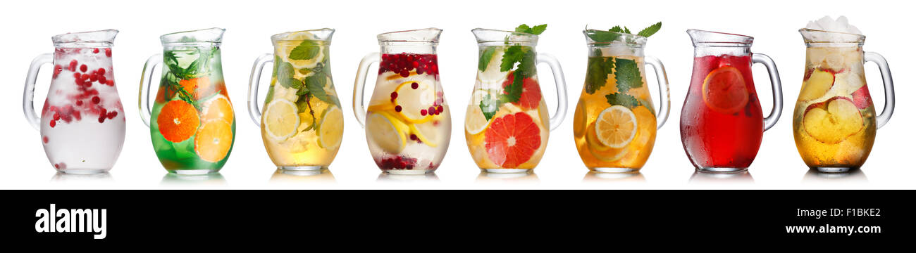 Collection of different drinks in glass pitchers. Jugs full of spritzers, schorle,lemonade,iced tea, detox waters. - Stock Image
