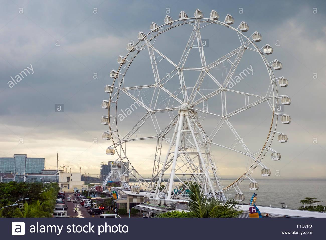 Mall of Asia Eye ferris wheel on Manila Bay, Pasay, Manila, National Capital Region, Philippines - Stock Image