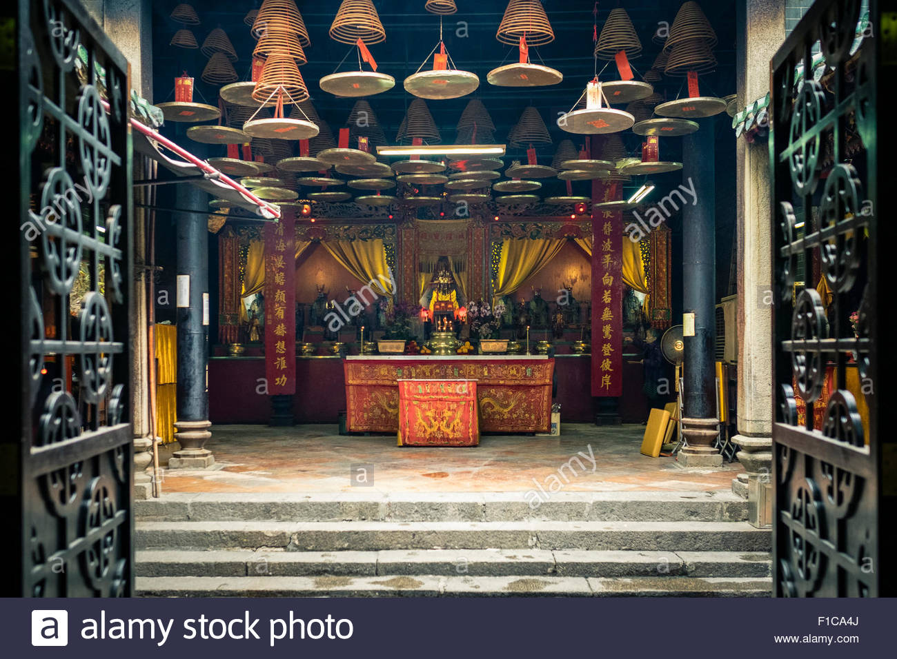 Shing Wong Temple altar at Tin Hau Temple, Yau Ma Tei, Kowloon, Hong Kong, China - Stock Image