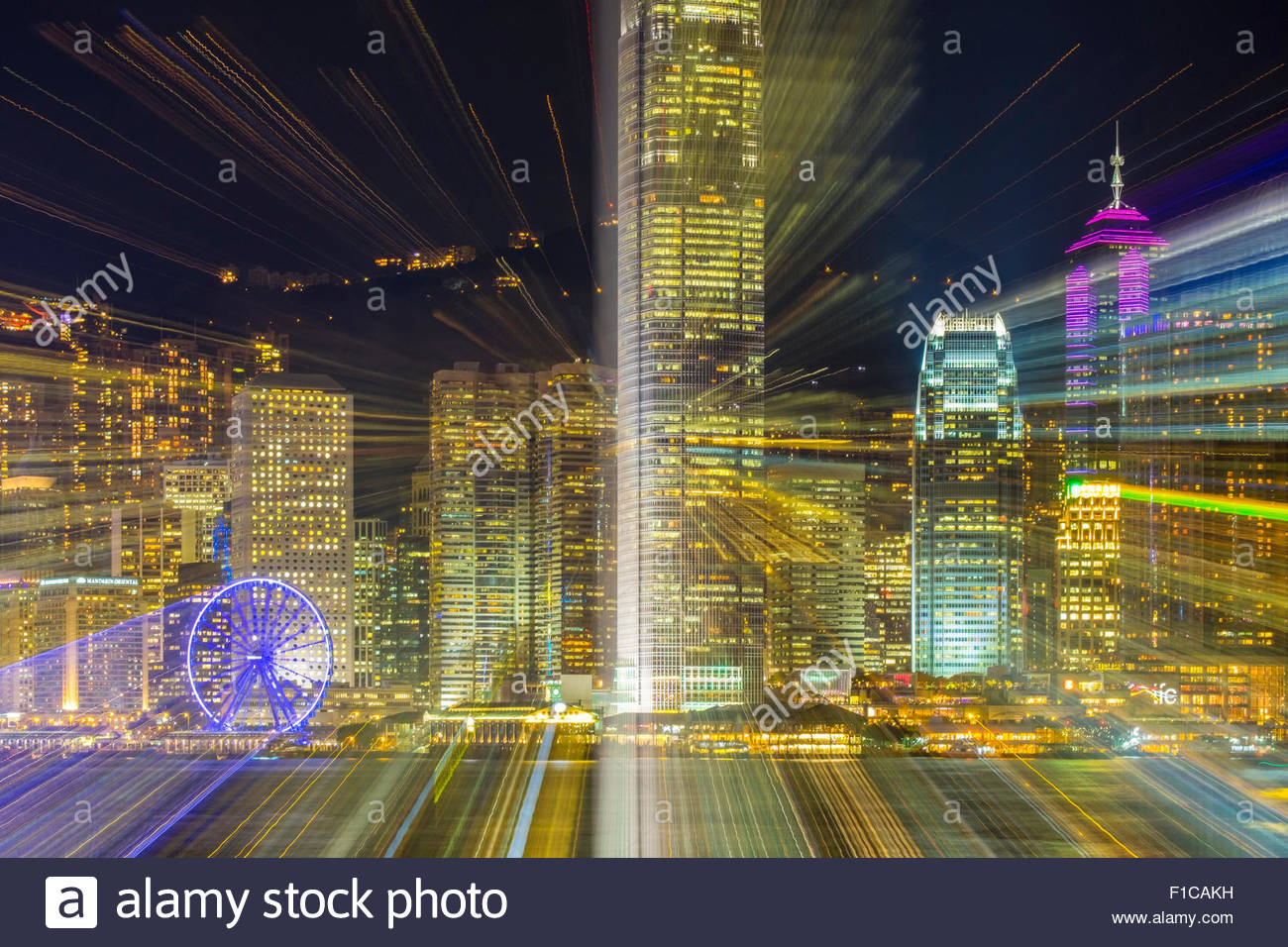 Lens zoom blur, long exposure of skyscrapers on Hong Kong Island at night, Hong Kong Island, Hong Kong, China - Stock Image