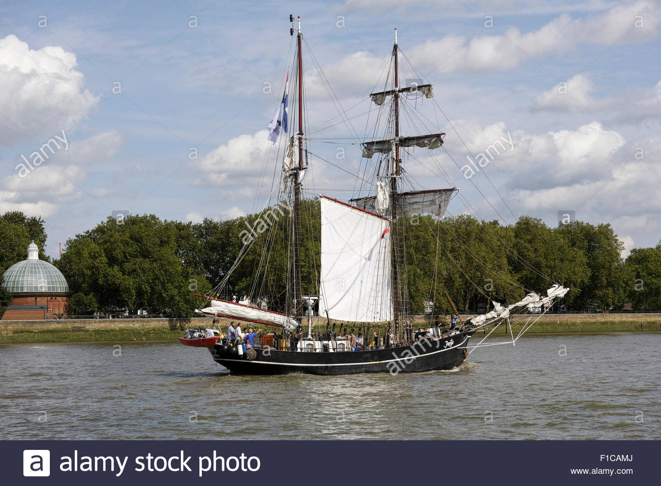 Historic schooner 'Jantje' passes Island Gardens on the Isle of Dogs during the Tall Ships Festival 2015 - Stock Image