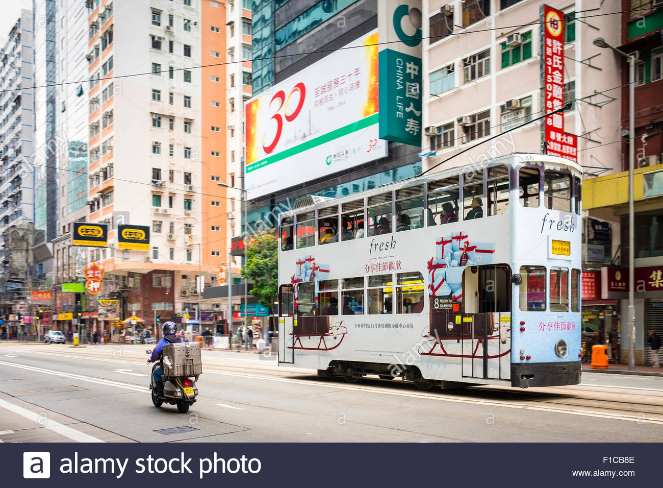 Double-Decker tram passing on Hennessy Road, Wan Chai, Hong Kong Island, Hong Kong, China - Stock Image