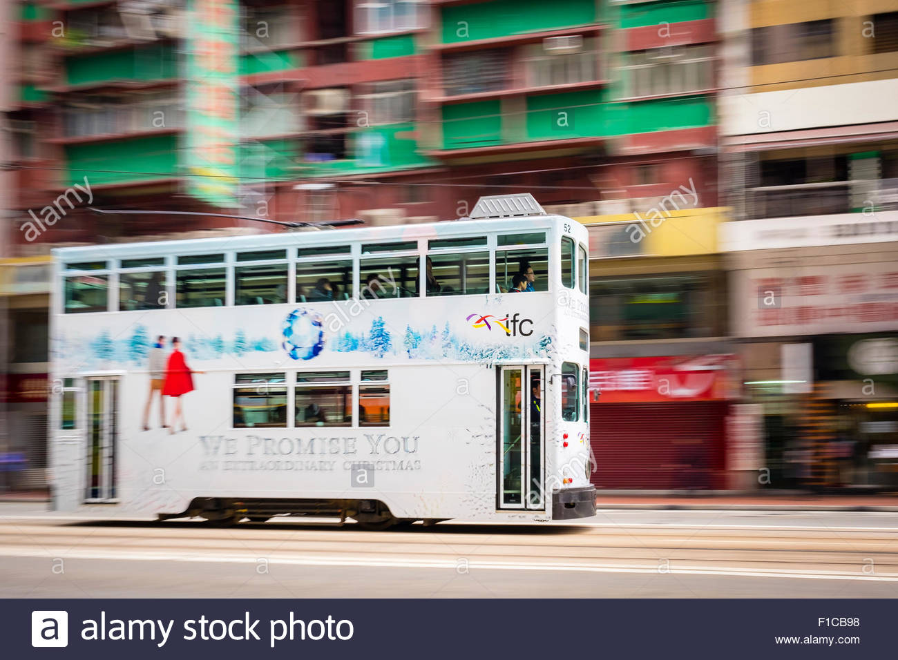 Motion blur pan, double-decker tram passing on Hennessy Road, Wan Chai, Hong Kong Island, Hong Kong, China - Stock Image
