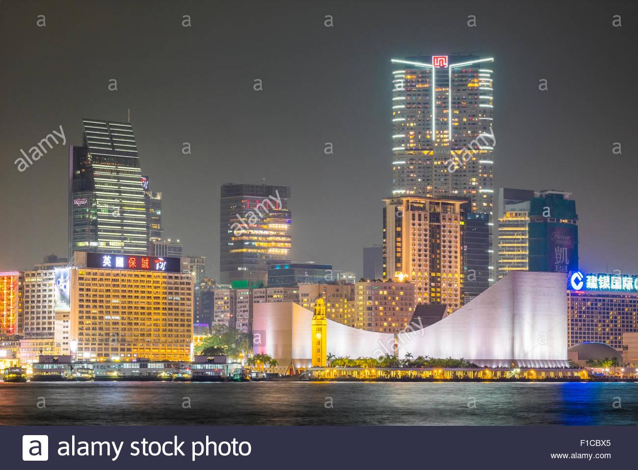 Hong Kong Cultural Centre and Tsim Sha Shui area at night, Kowloon, Hong Kong, China - Stock Image
