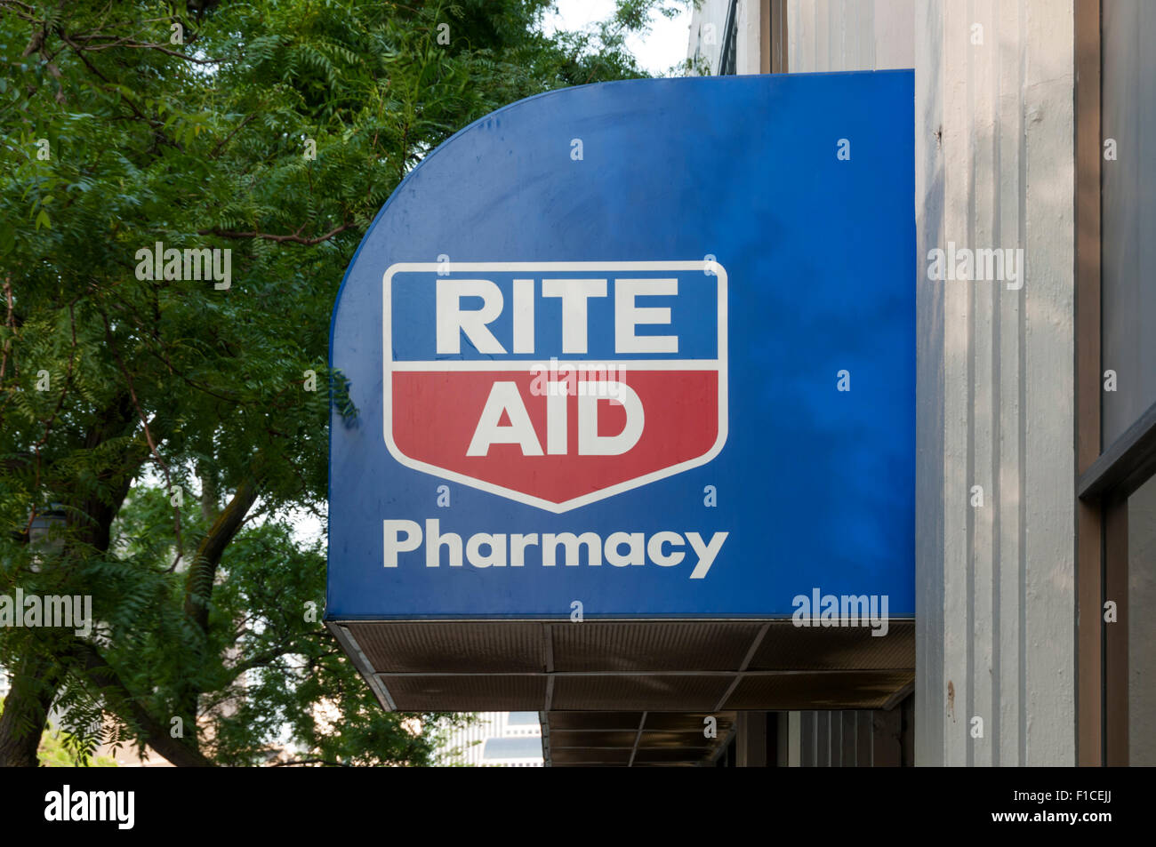 A sign for the Rite Aid drugstore chain in America. - Stock Image