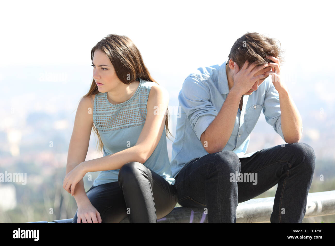 Bad girl arguing with her couple breakup concept with the city in the background - Stock Image