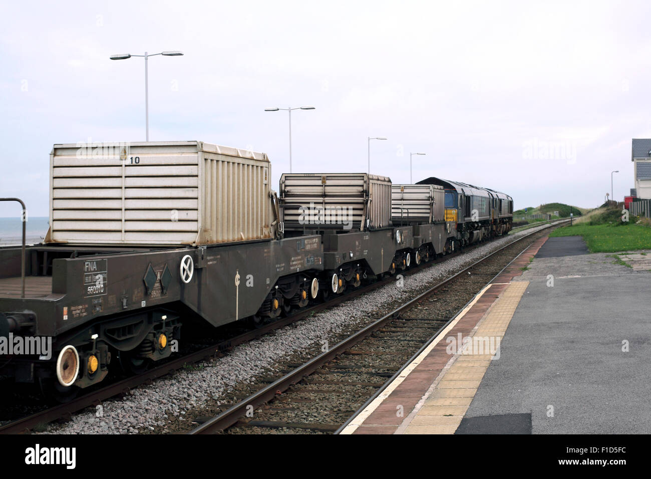 A train transporting three flasks of irradiated nuclear fuel ('nuclear waste') passes Seascale, Cumbria, - Stock Image