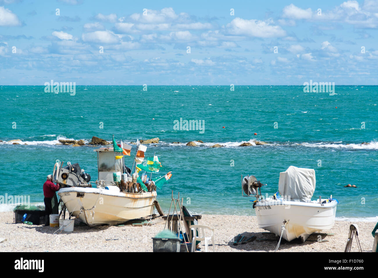 Sailor with Boats in Numana, Marches, Italy - Stock Image