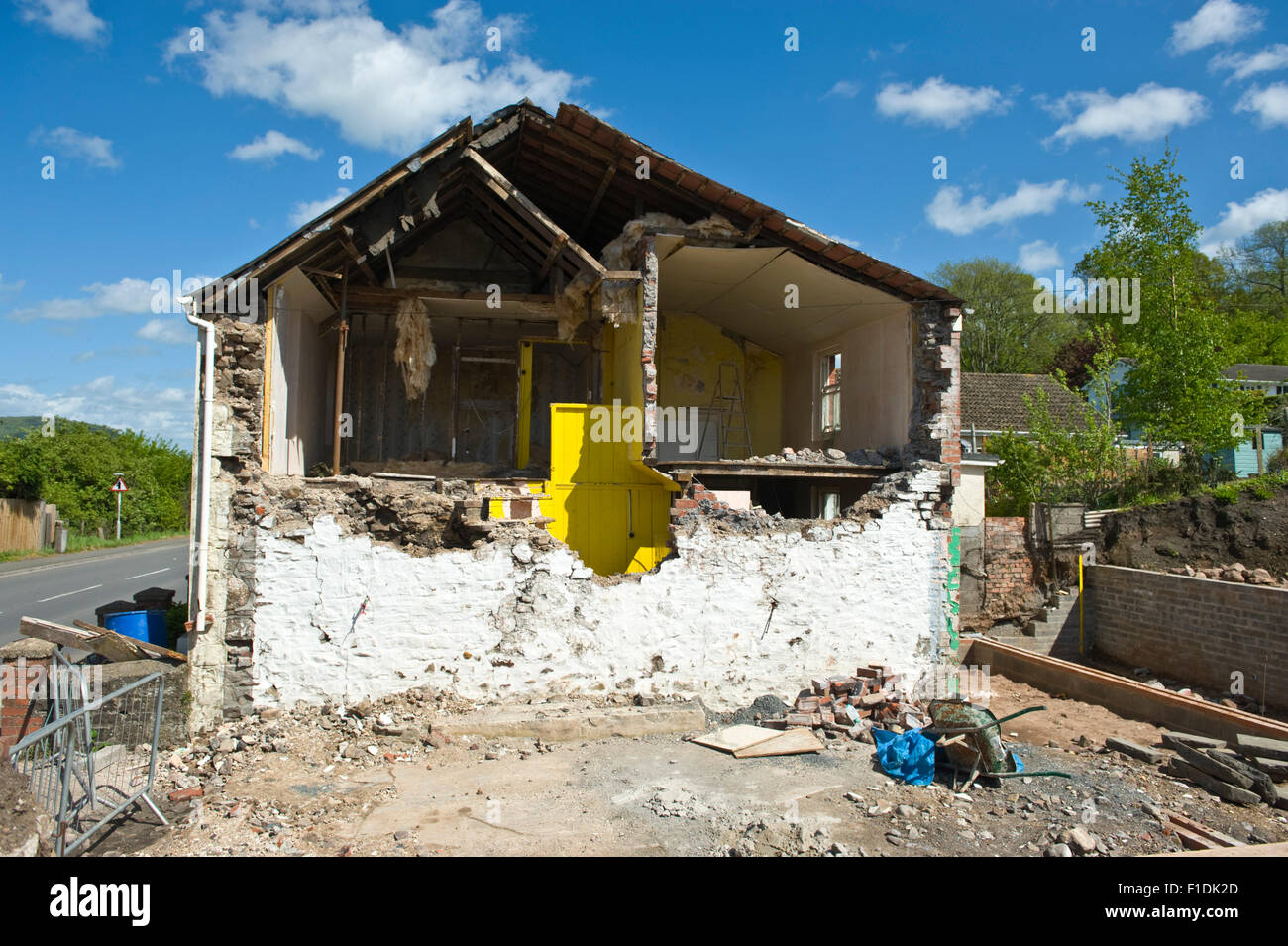 House in a dangerous state being rebuilt with an extension Gilwern Monmouthshire Wales UK - Stock Image