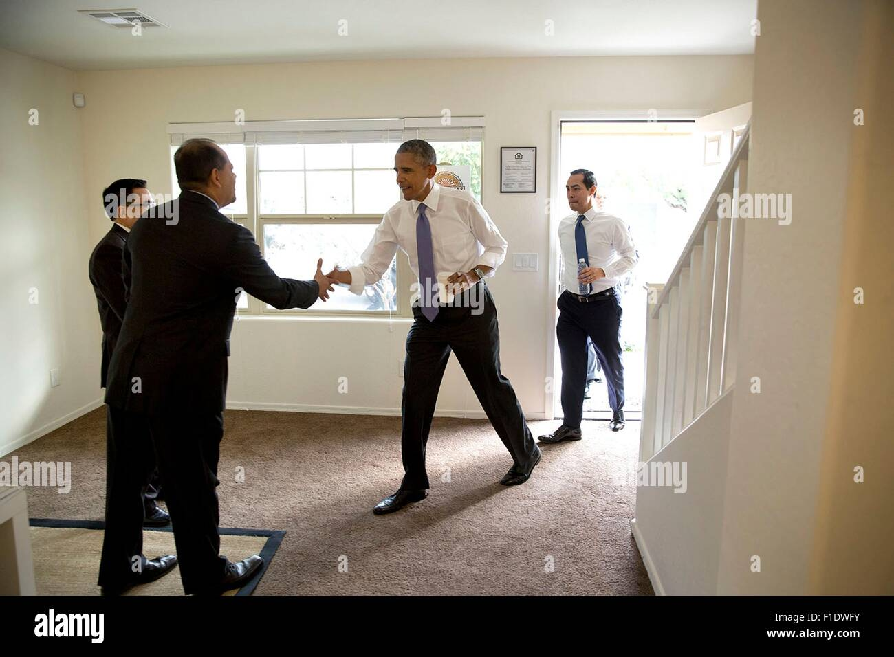 U.S. President Barack Obama and Housing and Urban Development Secretary Juli‡an Castro visit a model home at the - Stock Image