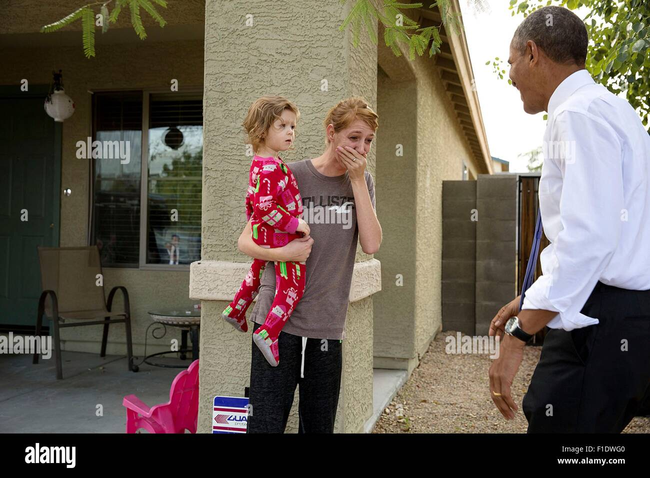 U.S. President Barack Obama surprises a neighbor living the Nueva Villas at Beverly, a single-family housing development - Stock Image