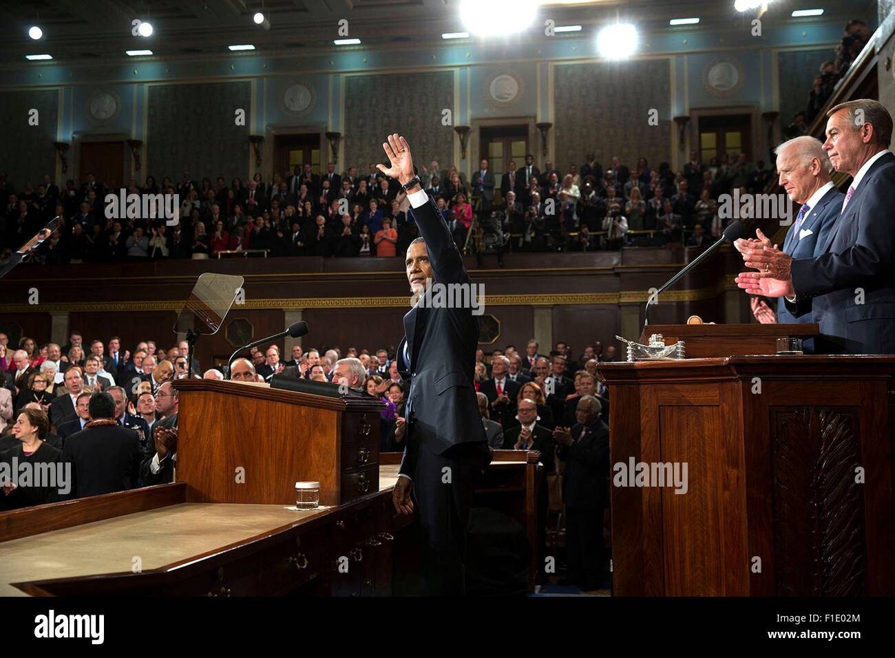 U.S. President Barack Obama acknowledges applause before he delivers the State of the Union address in the House - Stock Image