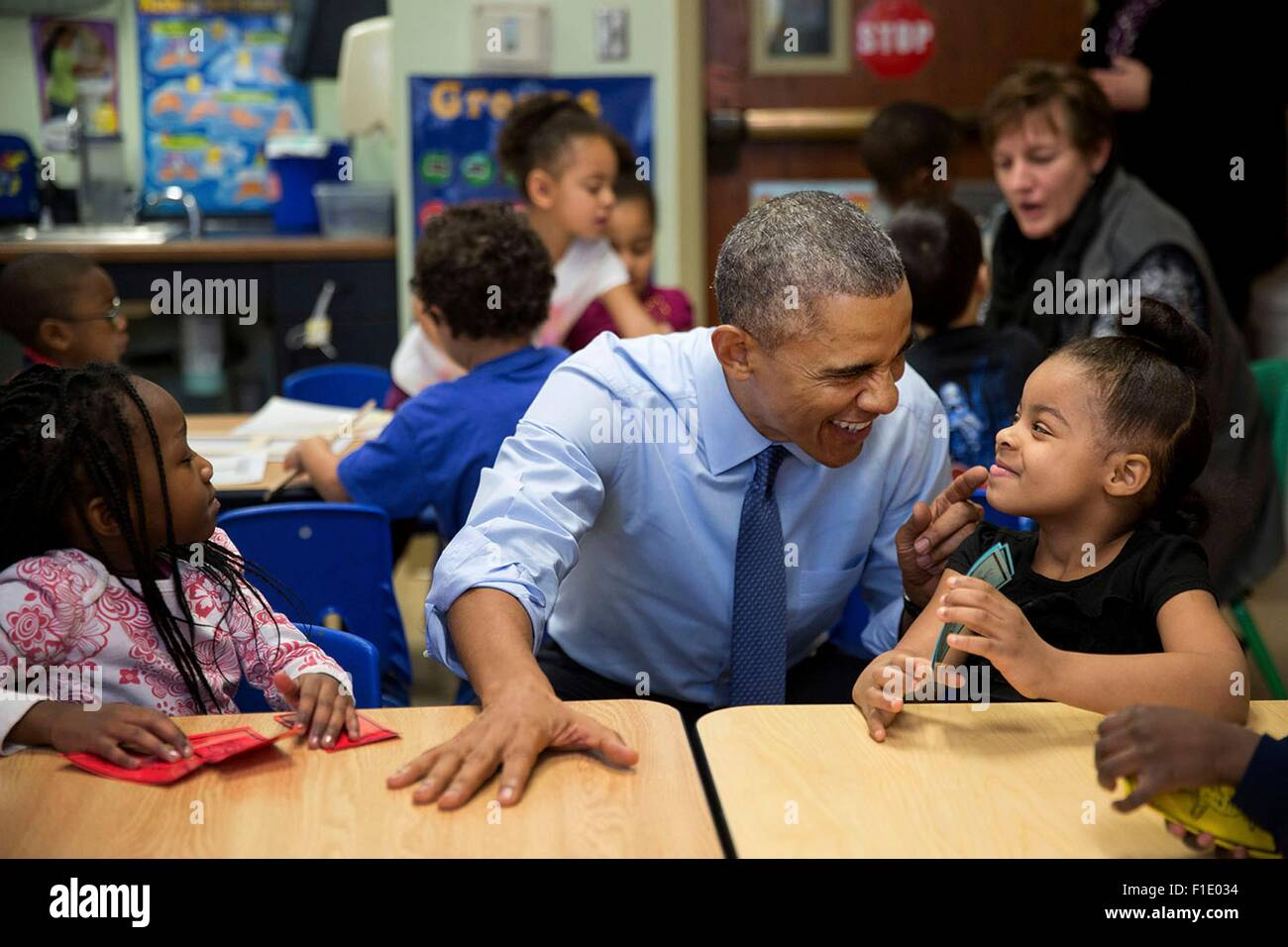 U.S. President Barack Obama gestures as he talks with Akira Cooper during a visit to the Community Children's - Stock Image