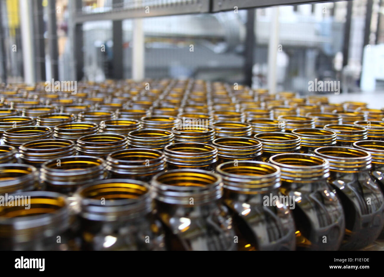 Marmite jars on the production line at the Unilever factory at Burton upon Trent in Staffordshire Stock Photo
