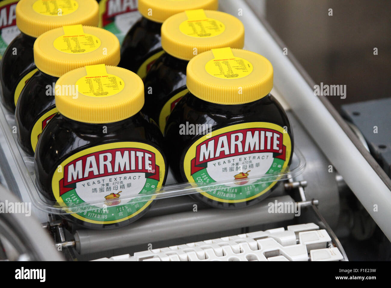 Marmite jars on the production line at the Unilever factory at Burton upon Trent in Staffordshire - Stock Image