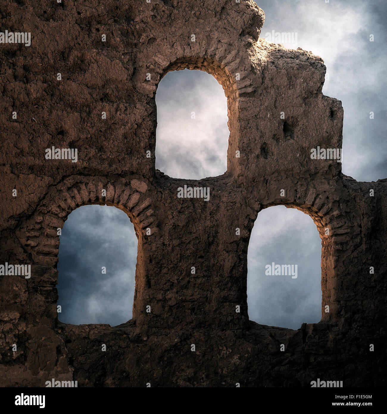 three windows in an old stone wall - Stock Image