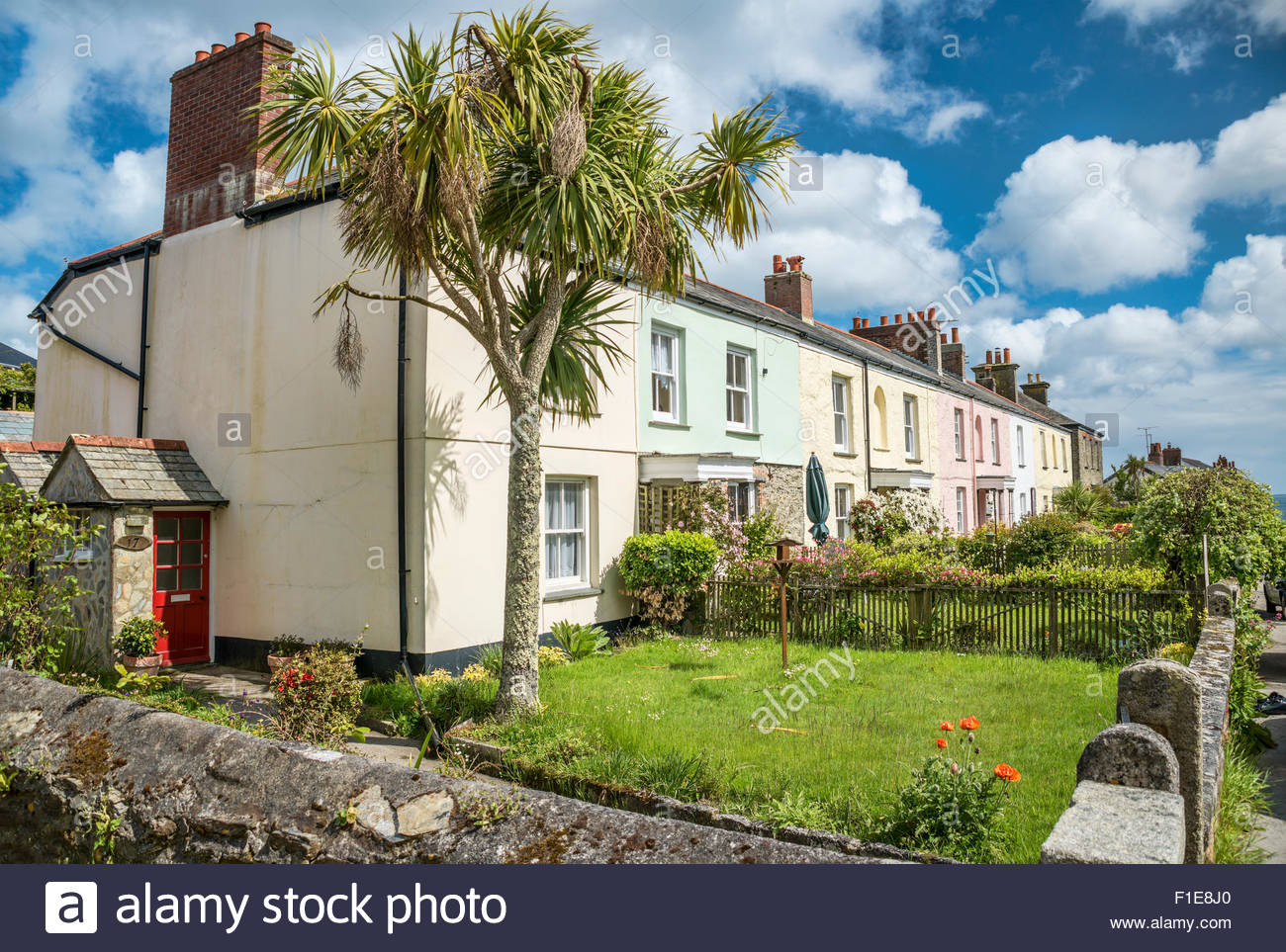 Cottages overlooking the inner harbour at Charlestown, Cornwall, England, UK - Stock Image