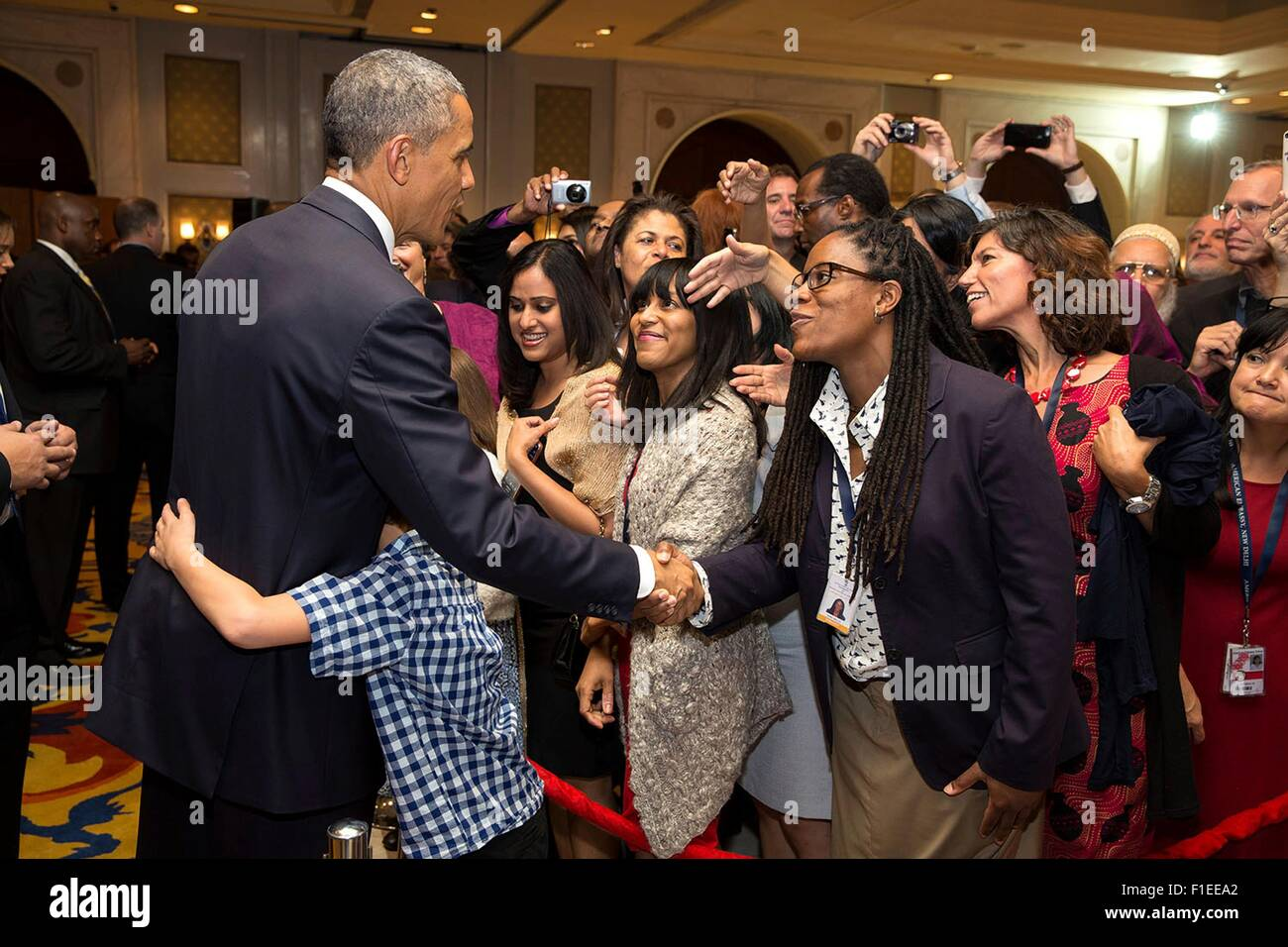 A young boy hugs President Barack Obama as he greets U.S. Embassy personnel and their families January 25, 2015 - Stock Image