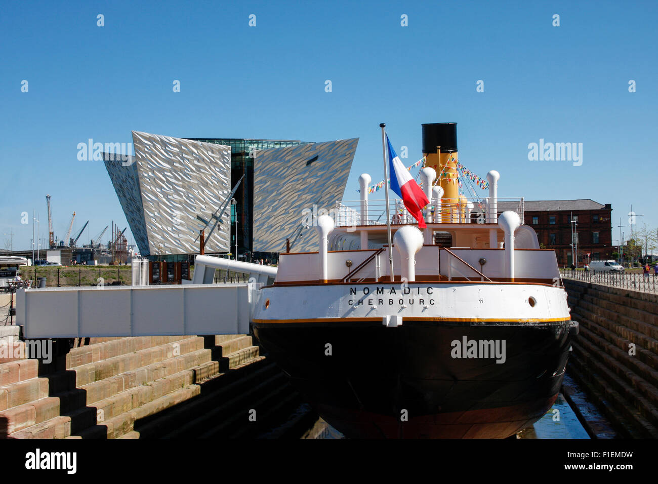 SS Nomadic, the last remaining ship of the White Star Line, in dry dock at Titanic Belfast Centre, Northern Ireland - Stock Image