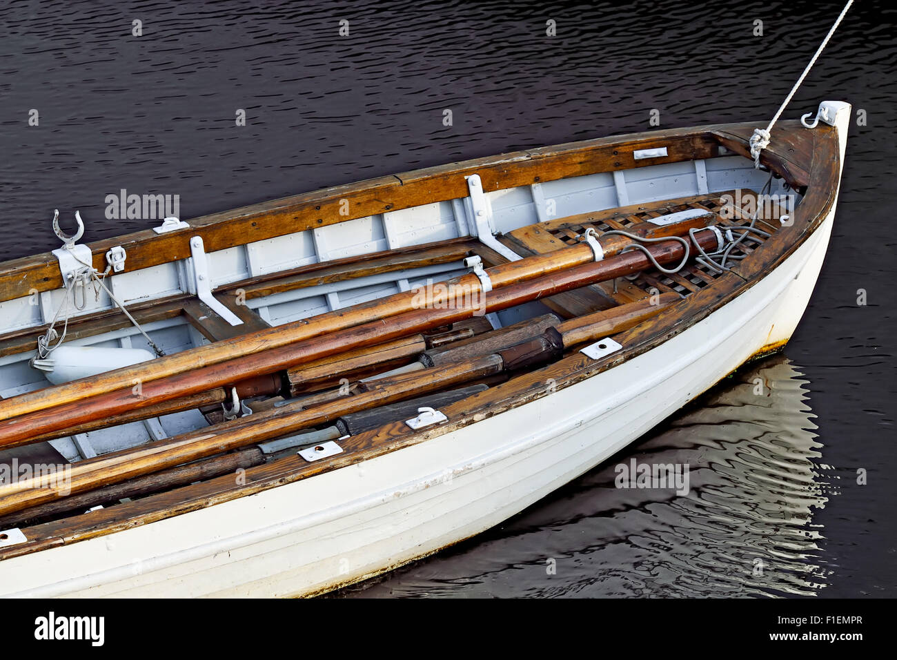 White rowing boat with folded oars closeup - Stock Image