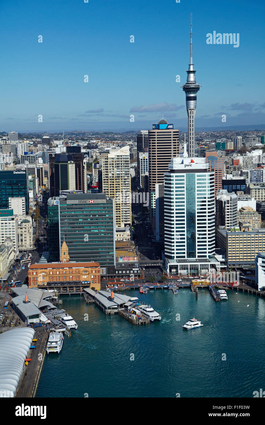 Passenger ferry terminal, Sky Tower, and waterfront, Auckland, North Island, New Zealand - aerial - Stock Image