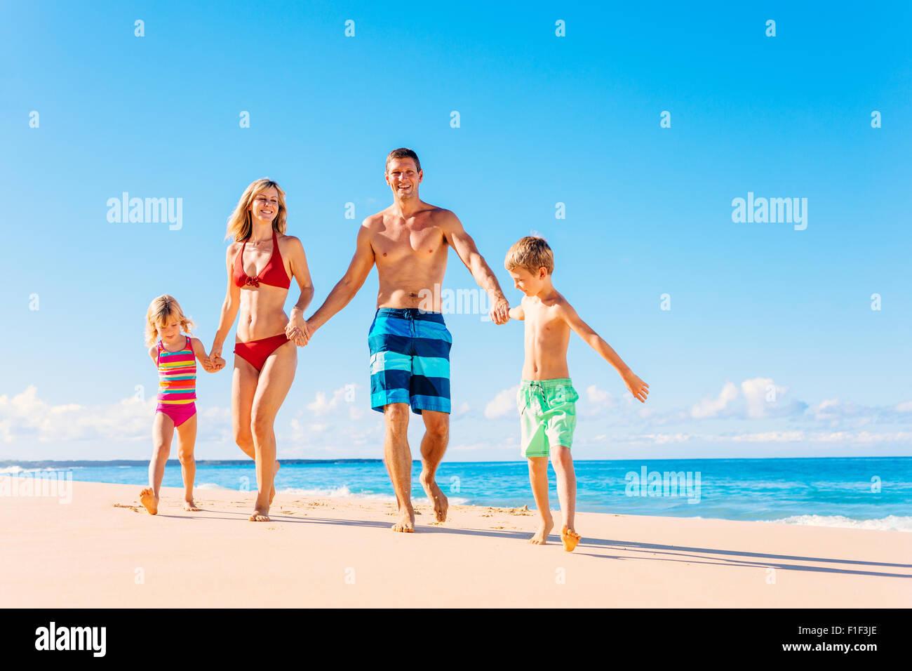 Family vacation. Happy family having fun on beautiful warm sunny beach. Summer lifestyle - Stock Image