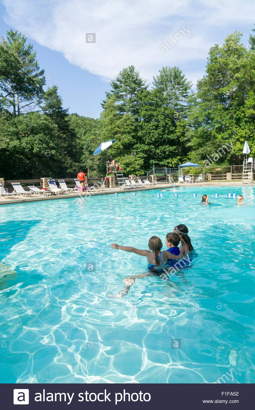 children play in the pool at lost river state park near mathias
