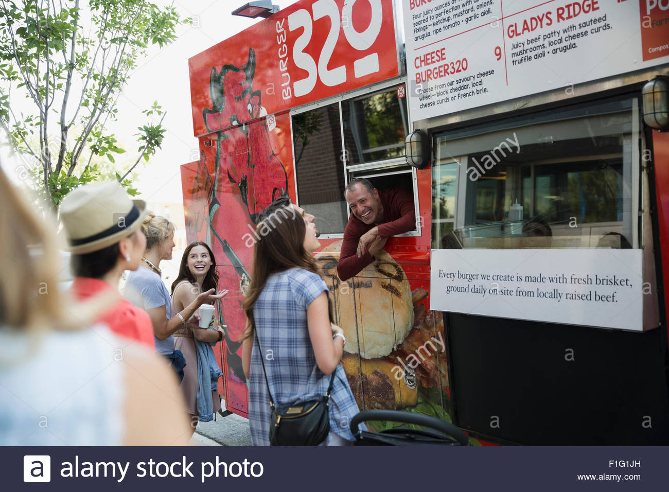 Customers ordering at food truck - Stock Image