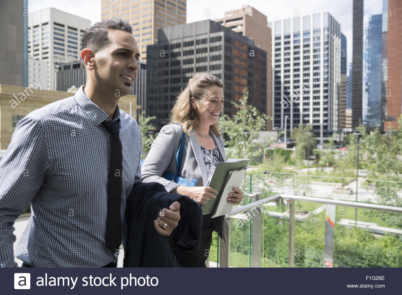 Business people walking in city - Stock Image
