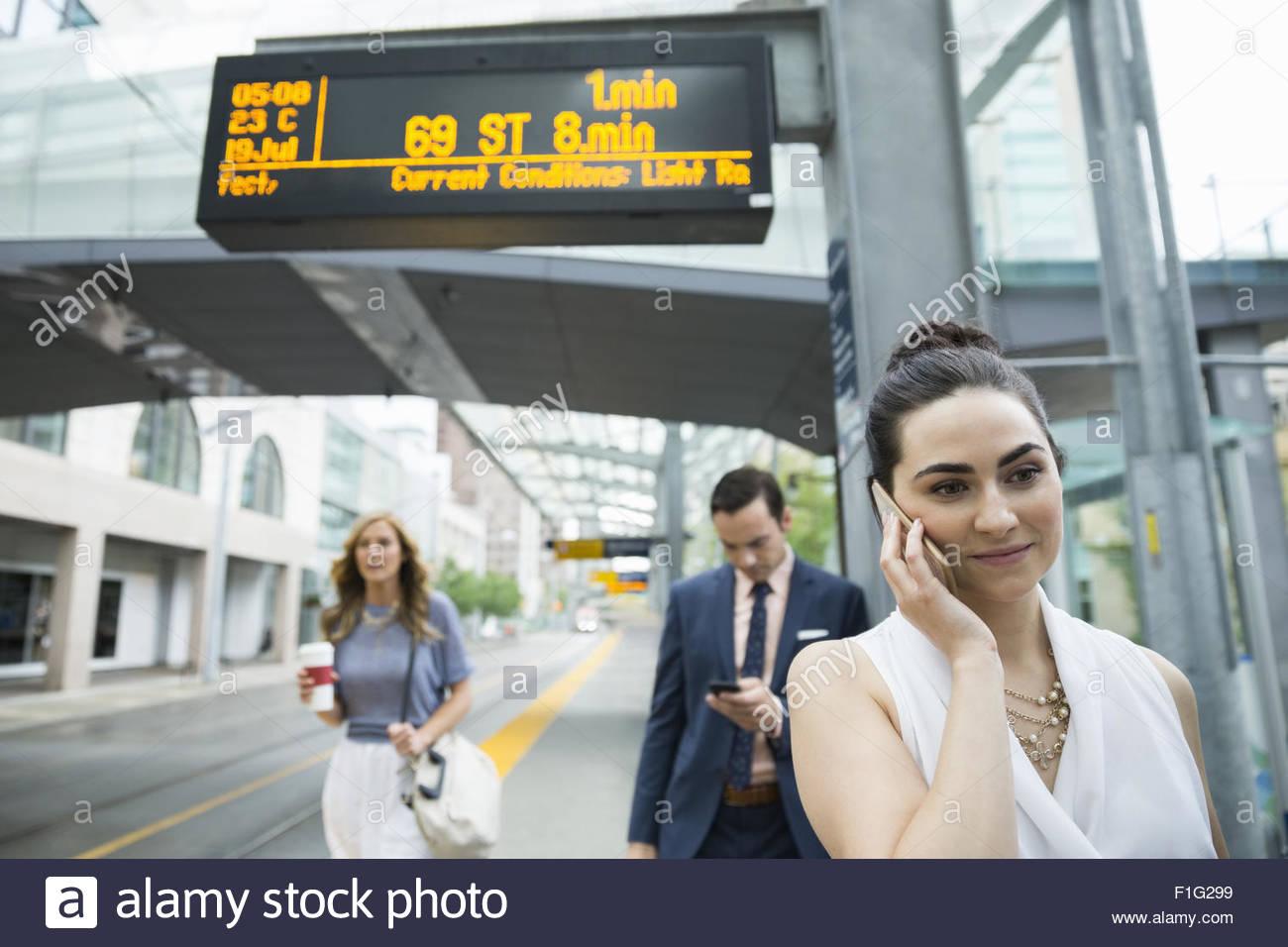 Business people waiting at train station platform Stock Photo