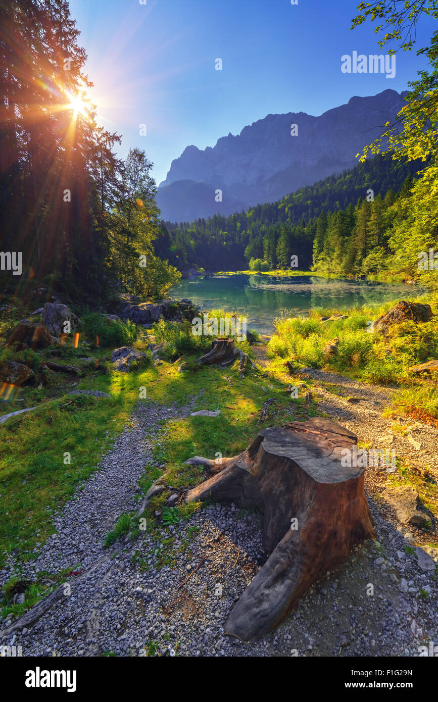Fantastic sunrise on mountain lake Eibsee, located in the Bavaria, Germany. Dramatic unusual scene. Alps, Europe. Stock Photo