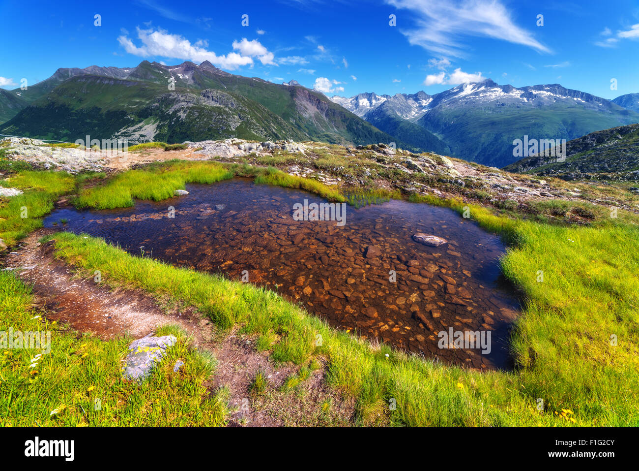 Amazing view of small lake near Totensee lake on the top of Grimselpass. Alps, Switzerland, Europe. - Stock Image