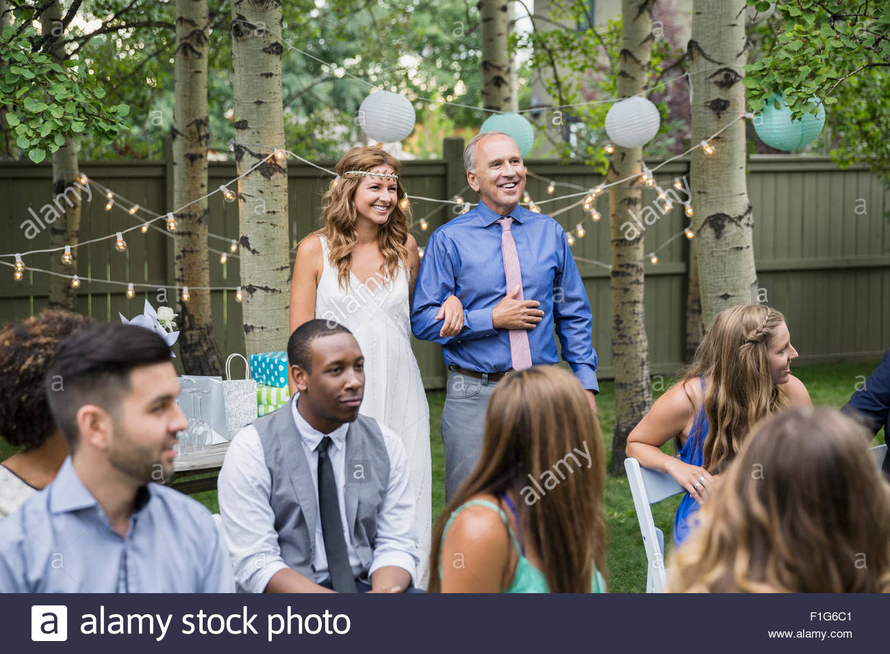 Father and bride ready at backyard wedding - Stock Image