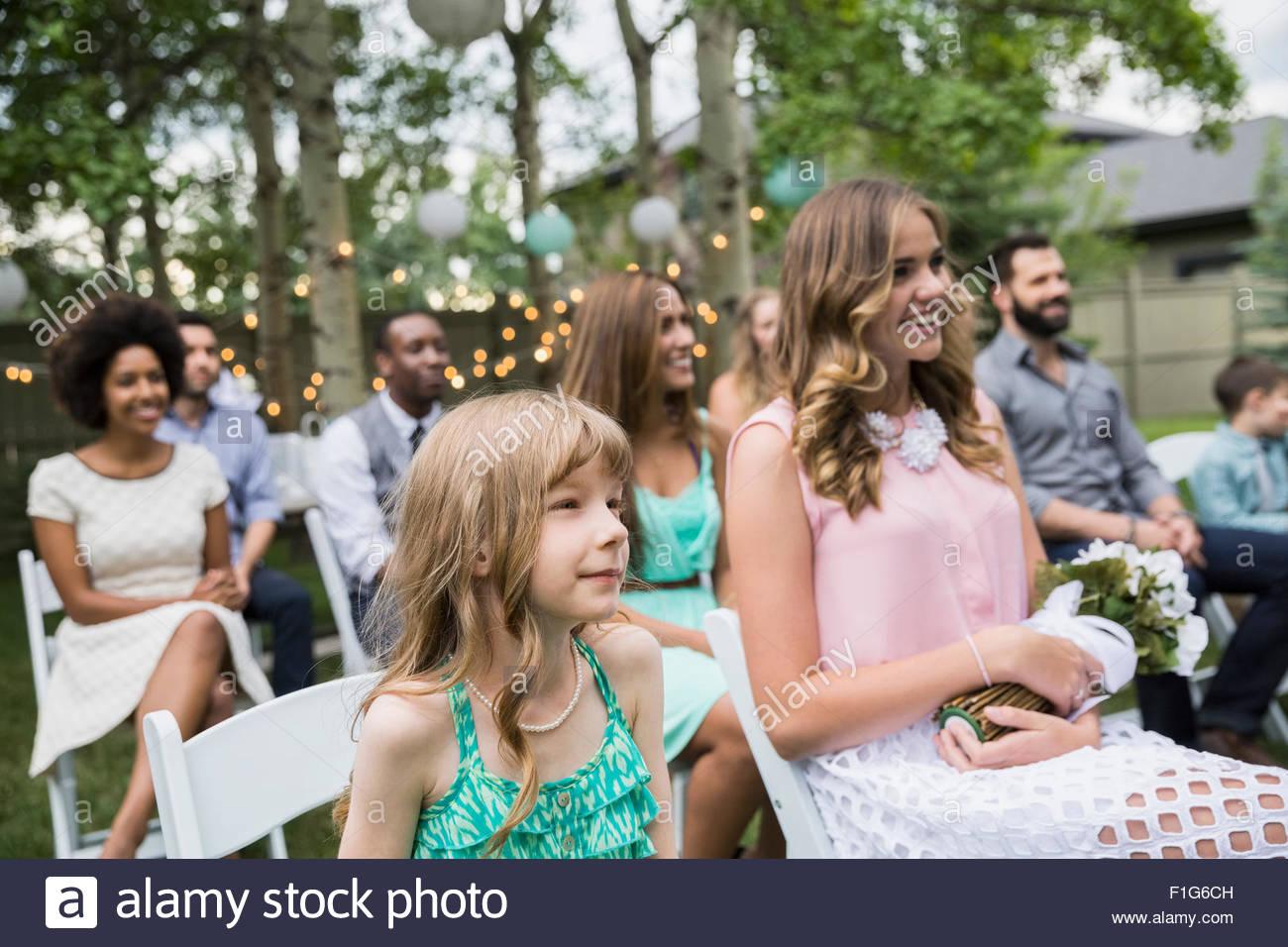 Smiling wedding guests enjoying backyard wedding Stock Photo