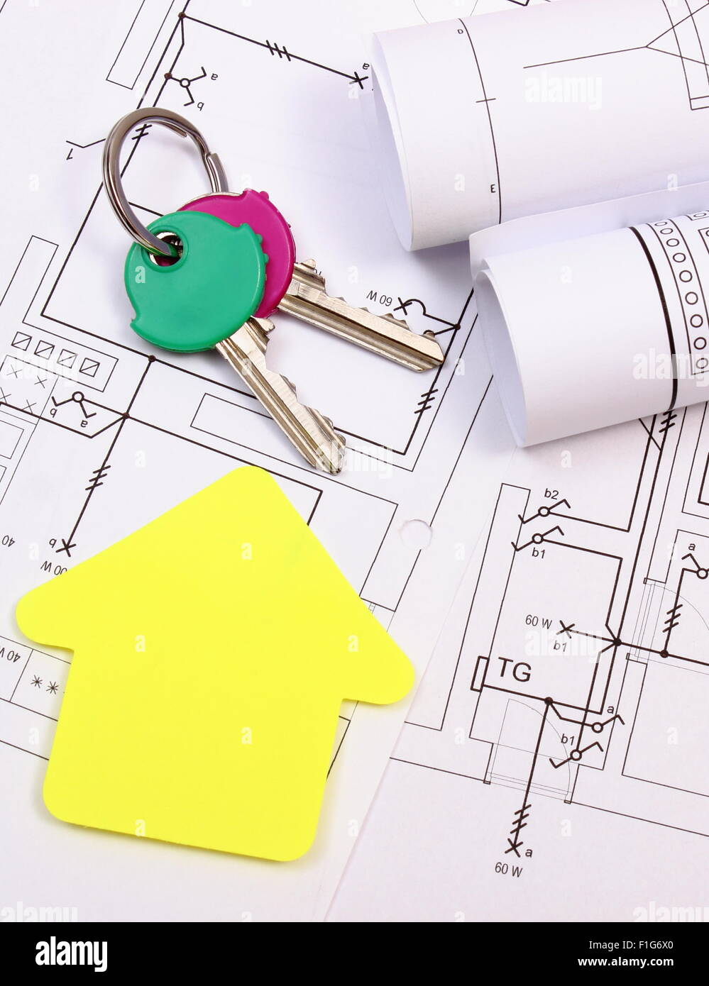 Electrical Housing Stock Photos Images Drawing For House Of Yellow Paper Home Keys And Rolls Diagrams Lying On Construction