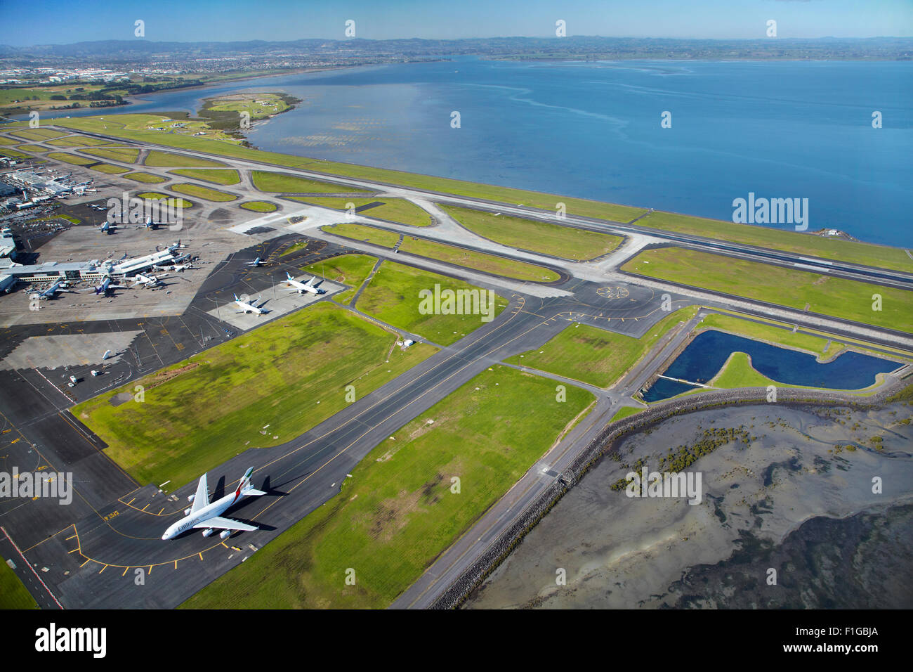 Emirates Airbus A380 and runways at Auckland Airport, North Island, New Zealand - aerial - Stock Image