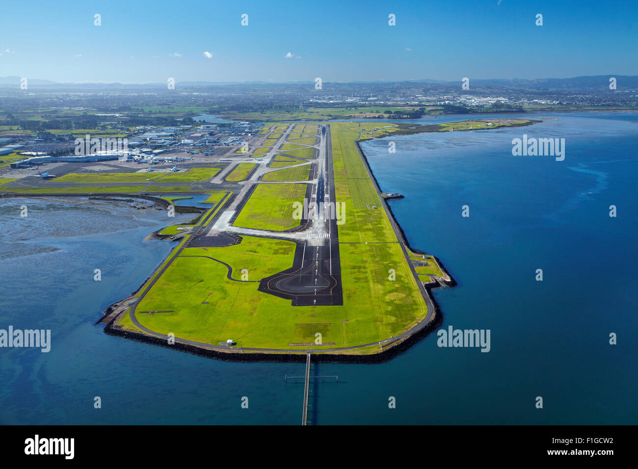 Runway at Auckland Airport, and Manukau Harbour, North Island, New Zealand - aerial - Stock Image