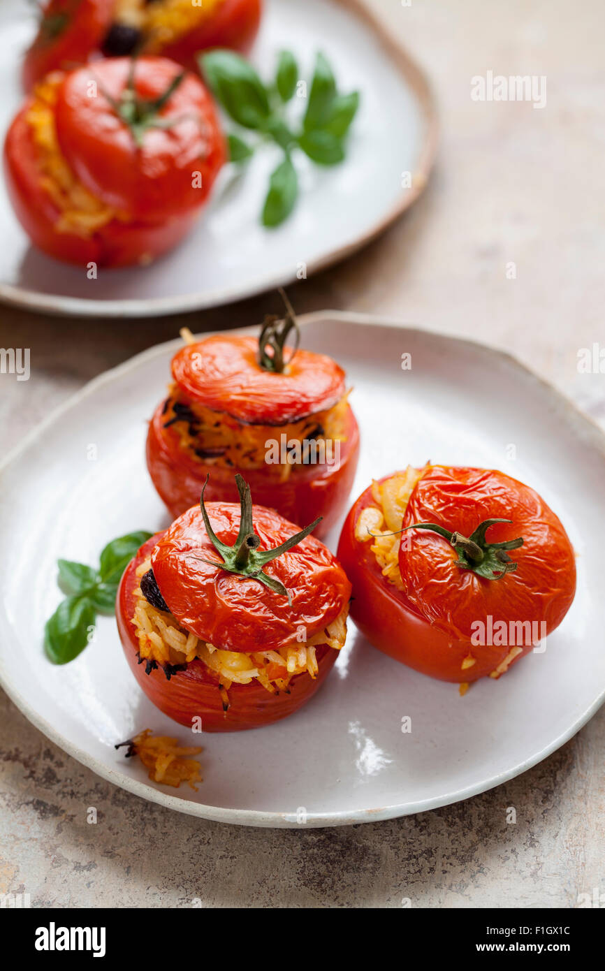Tomatoes stuffed with rice an pine nuts - Stock Image