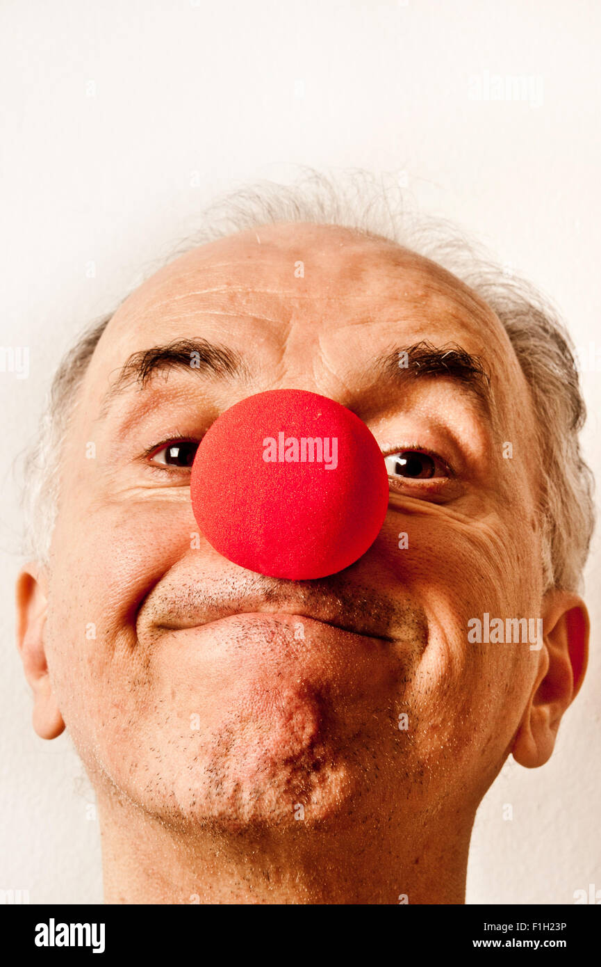 silly man with red clown nose - Stock Image