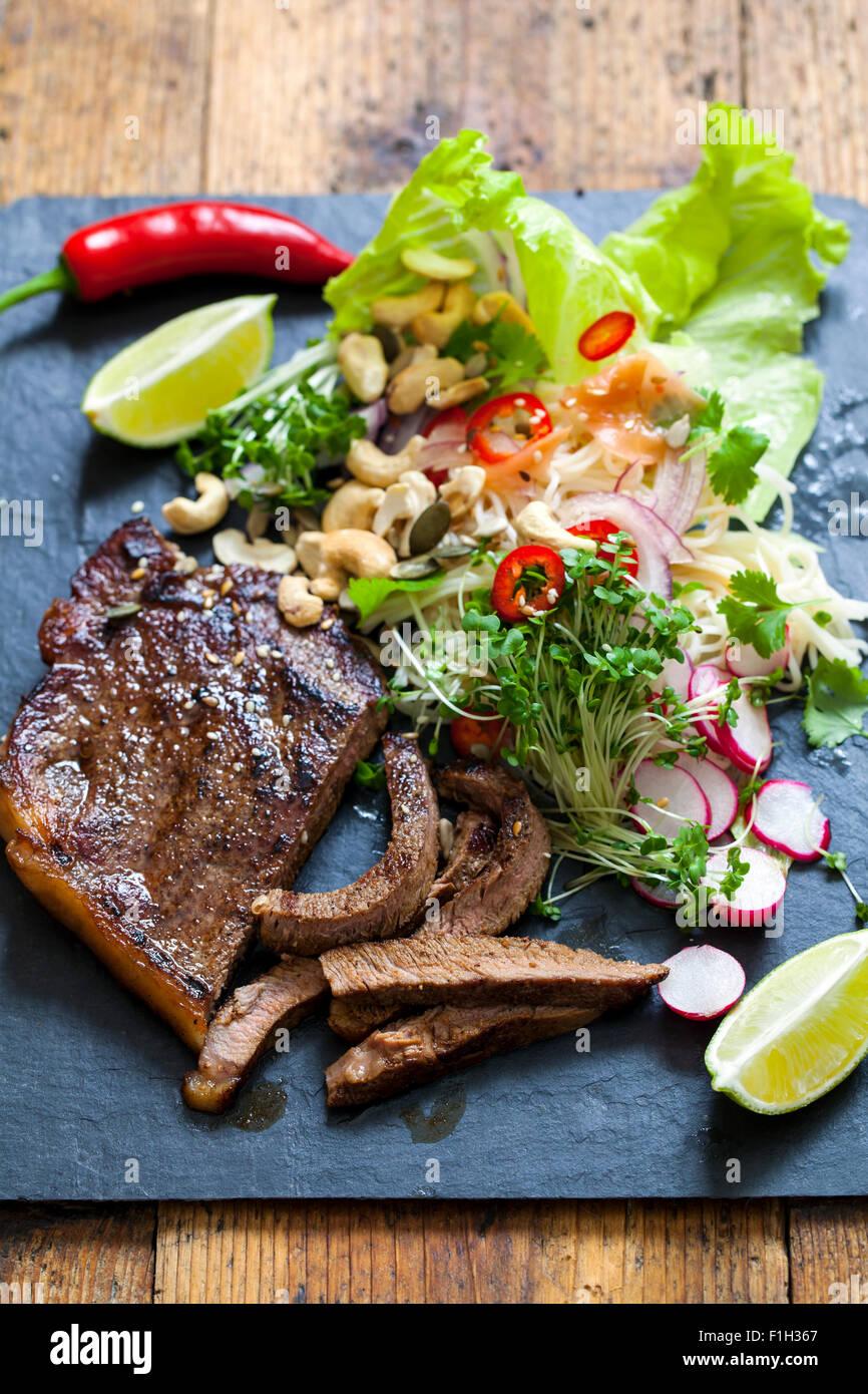 Oriental style beef salad - Stock Image